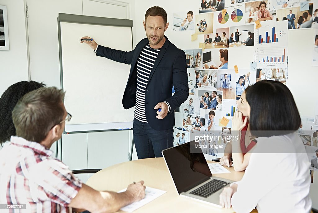 Creative businessman presenting project : Stock Photo