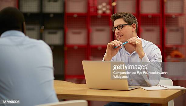 Creative businessman using laptop in office