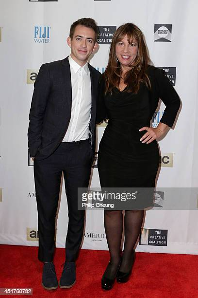 Creative Coalition CEO Robin Bronk and Actor Kevin McHale attend The Creative Coalition's Spotlight Initiative Awards Dinner during the 2014 Toronto...