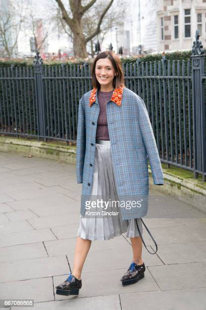 Creative consultant for art and culture and Artistic director for Spring Place Hikari Yokoyama wears a Christopher Kane coat Mouki Mou sweater...