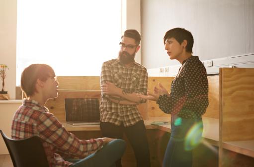 Creative coworkers having casual meeting