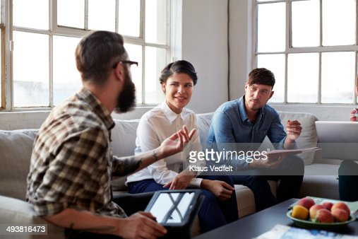 Creative Coworkers having meeting in couch