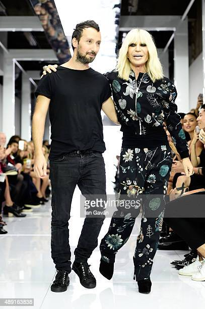 Creative director Anthony Vaccarello and Donatella Versace appear at on the runway at the Versus show during London Fashion Week Spring/Summer 2016...