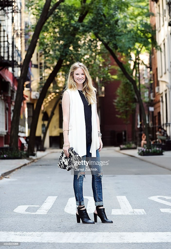 Creative Director at 41 Winks Olivia White is seen around Greenwich Village wearing a Theory Top, Rag and Bone vest, Citizens of Humanity jeans, Vince shoes and an Alexander McQueen purse on August 28, 2014 in New York City.