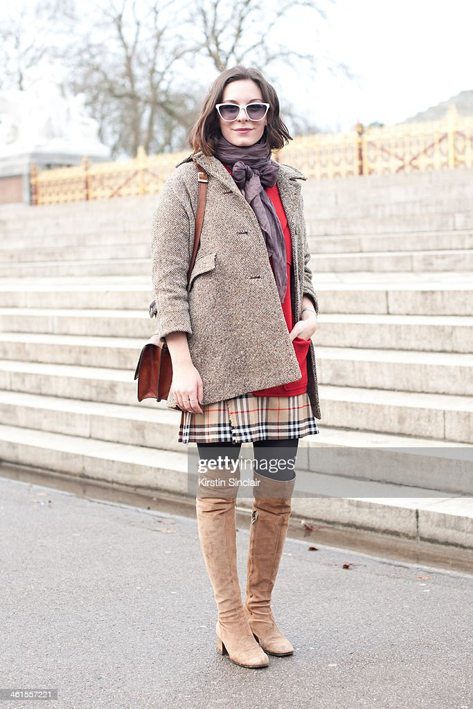 Creative director at Secret D'Or Andreea Bogdan wears a vintage coat and boots, Burberry skirt, Mugnai bag, Jean La Fore sunglasses and a YSL jacket day 3 of London Mens Fashion Week Autumn/Winter 2014, on January 08, 2014 in London, England.