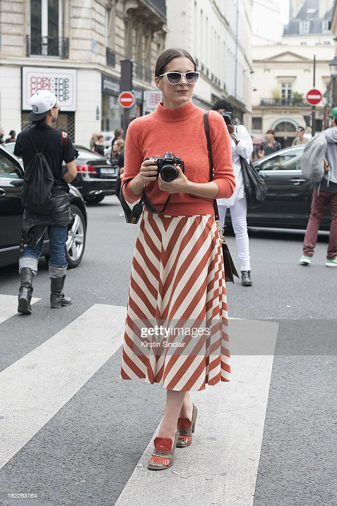 Creative director at Secret D'or Andreea Bogdan wears vintage bag skirt and sweater Jean Le Font sunglasses and Miu Miu shoes on day 5 of Paris...