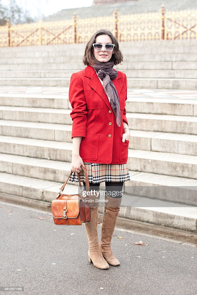 Creative director at Secret D'Or Andreea Bogdan wears vintage boots, Burberry skirt, Mugnai bag, Jean La Fore sunglasses and a YSL jacket day 3 of London Mens Fashion Week Autumn/Winter 2014, on January 08, 2014 in London, England.