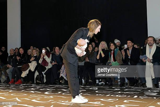 Creative Director Danielle Sherman greets fans from the runway during the Edun Fall 2016 fashion show during New York Fashion Week on February 14...
