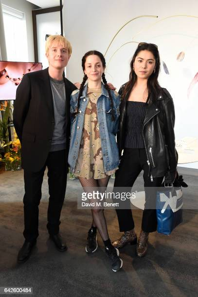 Creative director Dominic Jones poses with guests during the Astley Clarke AW17 Presentation during London Fashion Week at Savoy Place on February 18...