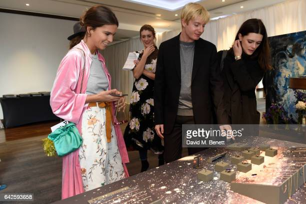 Creative director Dominic Jones shows the jewellery to clients and media during the Astley Clarke AW17 Presentation during London Fashion Week at...
