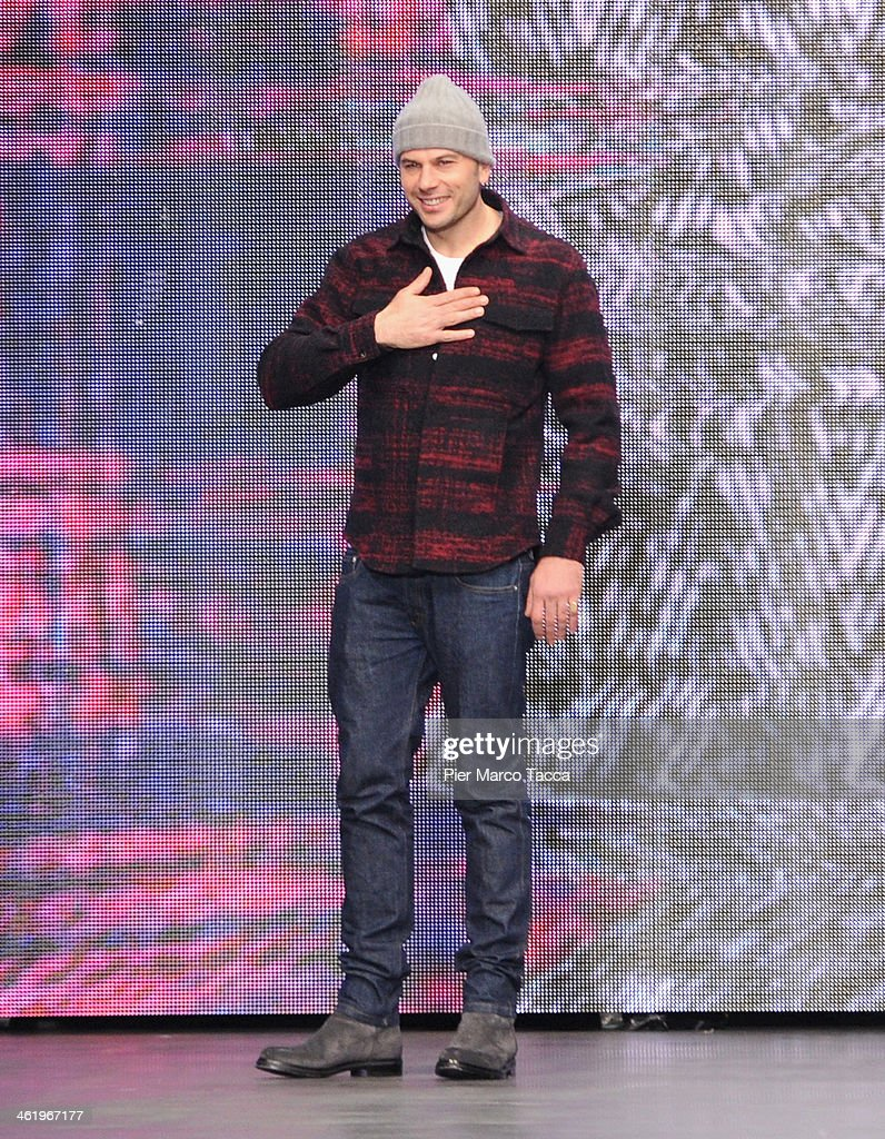 Creative Director Federico Curradi acknowledges the applause of the audience after the Iceberg show as a part of Milan Fashion Week Menswear Autumn/Winter 2014 on January 12, 2014 in Milan, Italy.
