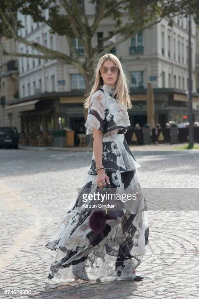 Creative Director Founder of Beyond The Mag Sophia Macks wears a MSGM dress Delvaux bag and Salvatore Ferragamo sunglasses day 4 of Paris Womens...