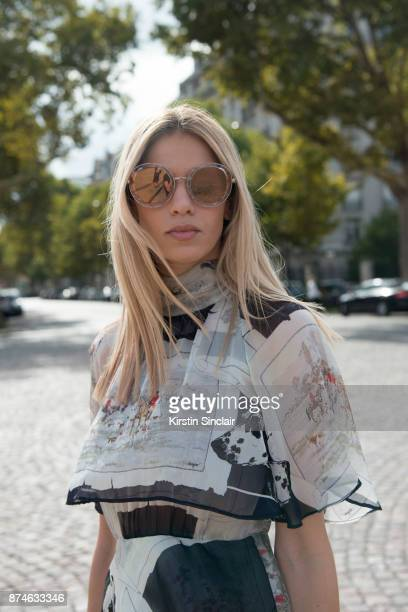 Creative Director Founder of Beyond The Mag Sophia Macks wears a MSGM dress and Salvatore Ferragamo sunglasses day 4 of Paris Womens Fashion Week...