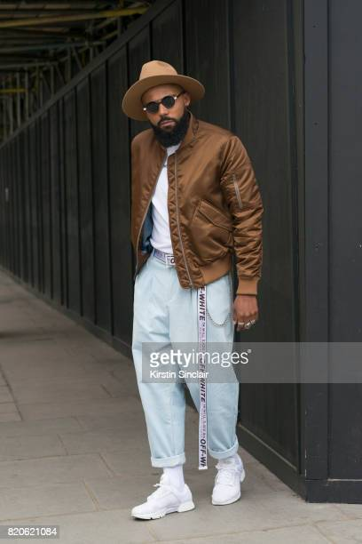 Creative director Jean Claude Mpassy wears Adidas trainers Rabbit Hole London trousers A Million Dollars shirt Tiger of Sweden jacket and hat Off...