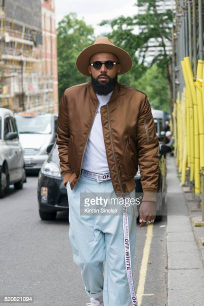 Creative director Jean Claude Mpassy wears Rabbit Hole London trousers A Million Dollars shirt Tiger of Sweden jacket and hat Off White belt and...