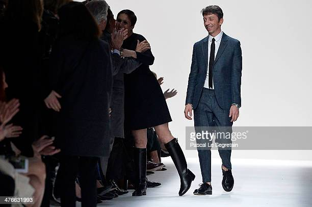 Creative Director Maria Grazia Chiuri receives an embrace from Valentino as Creative Director Pier Paolo Piccioli looks upon them after the Valentino...