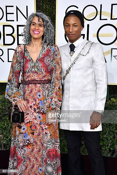 Creative director Mimi Valdes and musician Pharrell Williams attend the 74th Annual Golden Globe Awards at The Beverly Hilton Hotel on January 8 2017...
