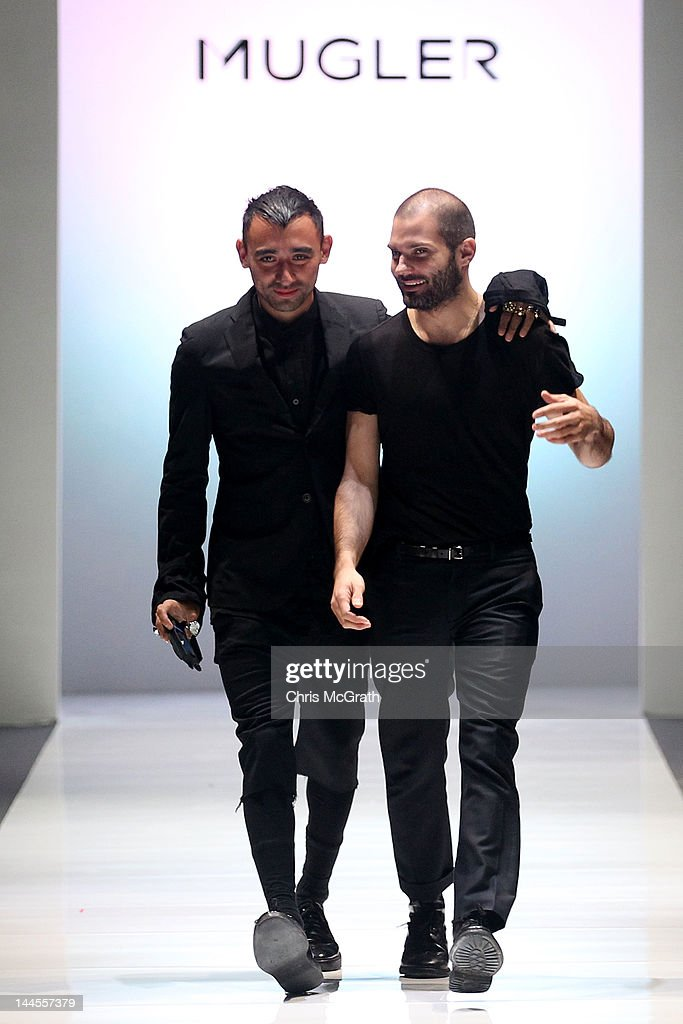 Creative director <a gi-track='captionPersonalityLinkClicked' href=/galleries/search?phrase=Nicola+Formichetti&family=editorial&specificpeople=7376980 ng-click='$event.stopPropagation()'>Nicola Formichetti</a> (L) and designer Thierry Mugler walk the runway during the Audi Fashion Festival Opening Show of Mugler A/W 2012 with <a gi-track='captionPersonalityLinkClicked' href=/galleries/search?phrase=Nicola+Formichetti&family=editorial&specificpeople=7376980 ng-click='$event.stopPropagation()'>Nicola Formichetti</a> at the Tent@Orchard on May 16, 2012 in Singapore. Audi Fashion Festival, part of Asia Fashion Exchange which takes place from May 14-20, is a showcase of collections by top and emerging designers and labels, both international and Asian, hoping to position Singapore as Asia's fashion hub.