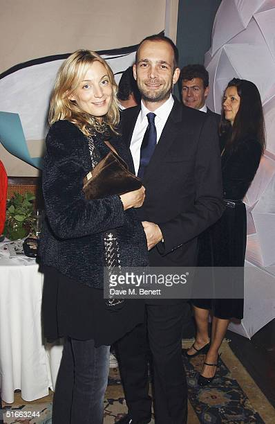 Creative Director of Chloe Phoebe Philo and partner artist Max Wigram attend the Vogue and Motorola Private VIP Party launching Vogue's December 2004...