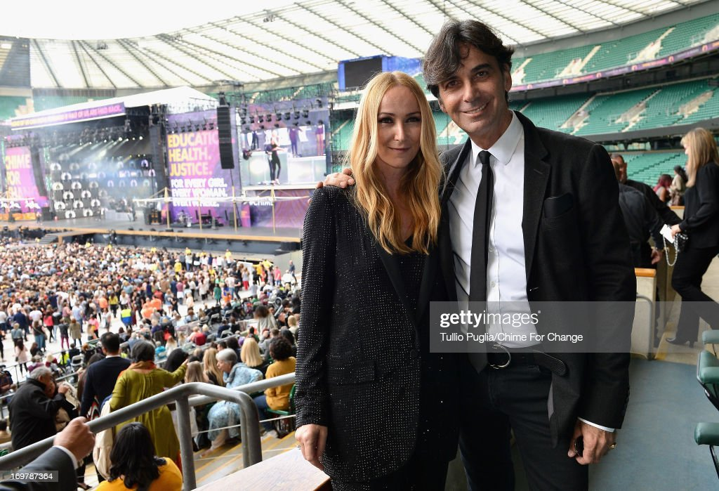 Creative Director of Gucci <a gi-track='captionPersonalityLinkClicked' href=/galleries/search?phrase=Frida+Giannini&family=editorial&specificpeople=559380 ng-click='$event.stopPropagation()'>Frida Giannini</a> and CEO of Gucci Patrizio di Marco pose inside the Royal Box at the 'Chime For Change: The Sound Of Change Live' Concert at Twickenham Stadium on June 1, 2013 in London, England. Chime For Change is a global campaign for girls' and women's empowerment founded by Gucci with a founding committee comprised of Gucci Creative Director <a gi-track='captionPersonalityLinkClicked' href=/galleries/search?phrase=Frida+Giannini&family=editorial&specificpeople=559380 ng-click='$event.stopPropagation()'>Frida Giannini</a>, Salma Hayek Pinault and Beyonce Knowles-Carter.