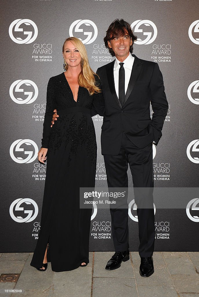 Creative Director of Gucci <a gi-track='captionPersonalityLinkClicked' href=/galleries/search?phrase=Frida+Giannini&family=editorial&specificpeople=559380 ng-click='$event.stopPropagation()'>Frida Giannini</a> and Managing Director of Gucci Patrizio di Marco attend the Gucci Award for Women in Cinema at The 69th Venice International Film Festival at Hotel Cipriani on August 31, 2012 in Venice, Italy.