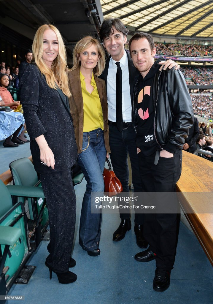 Creative Director of Gucci Frida Giannini, <a gi-track='captionPersonalityLinkClicked' href=/galleries/search?phrase=Isabella+Ferrari&family=editorial&specificpeople=630378 ng-click='$event.stopPropagation()'>Isabella Ferrari</a>, CEO of Gucci Patrizio di Marco and <a gi-track='captionPersonalityLinkClicked' href=/galleries/search?phrase=Elio+Germano&family=editorial&specificpeople=2154181 ng-click='$event.stopPropagation()'>Elio Germano</a> pose inside the Royal Box at the 'Chime For Change: The Sound Of Change Live' Concert at Twickenham Stadium on June 1, 2013 in London, England. Chime For Change is a global campaign for girls' and women's empowerment founded by Gucci with a founding committee comprised of Gucci Creative Director Frida Giannini, Salma Hayek Pinault and Beyonce Knowles-Carter.