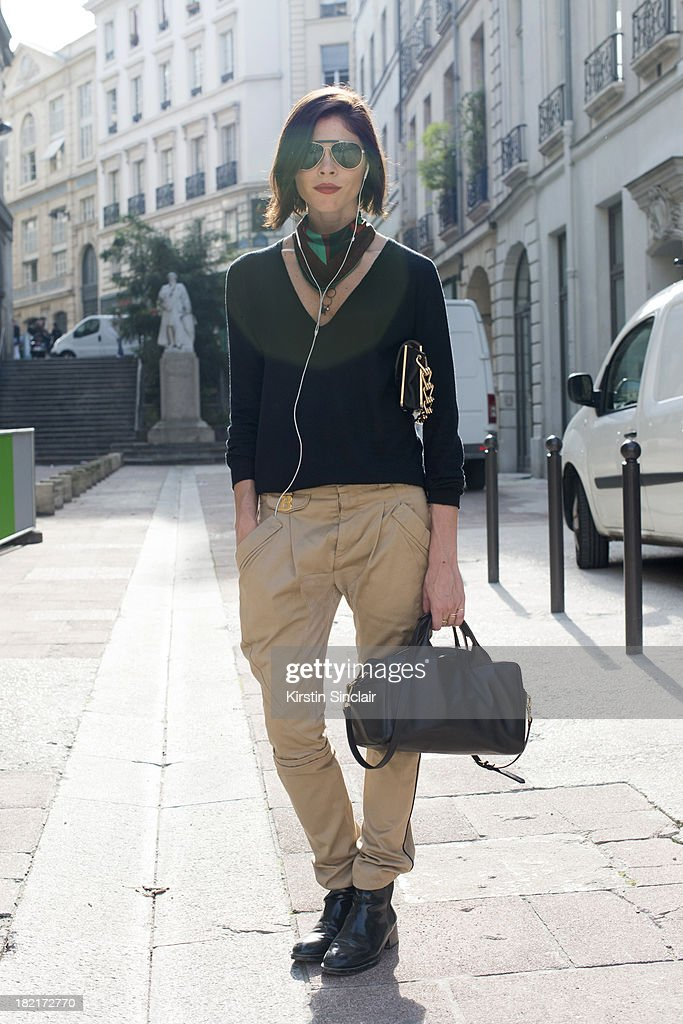 Creative director of Into The Gloss Emily Weiss wears Balenciaga trousers, Reed Krakoff bag, Zara shoes and a Joseph sweater on day 4 of Paris Fashion Week Spring/Summer 2014, Paris September 27, 2013 in Paris, France.