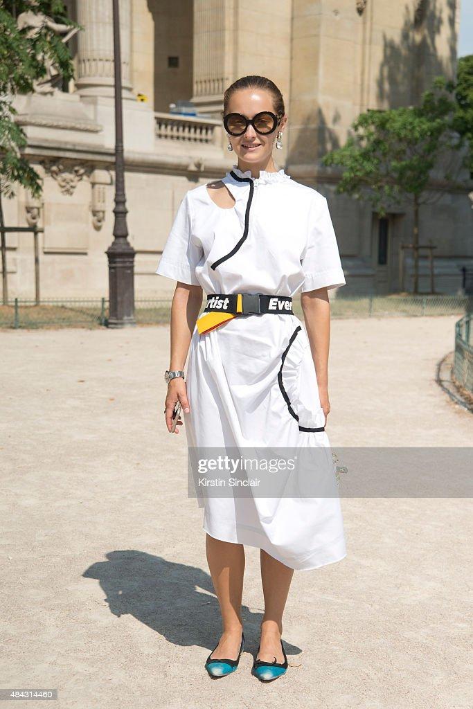Creative Director of MercedesBenz fashion week Kiev Daria Shapovalova wears Anton Belinskiy dress KKYE bag Prada shoes and sunglasses on day 3 of...