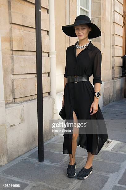 Creative Director of MercedesBenz Kiev Daria Shapovalova is wearing an Alexander Wang dress Saint Laurent belt and bag Dior shoes Vintage hat and Miu...