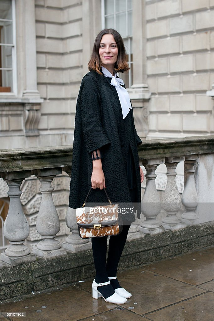 Creative Director of Secret Door Andreea Bogdan wears all vintage on day 1 of London Fashion Week Spring/Summer 2013, at Somerset House on September 13, 2013 in London, England.