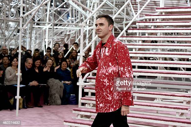 Creative Director Raf Simons appears at the end of the runway after the Christian Dior show as part of Paris Fashion Week Haute Couture Spring/Summer...