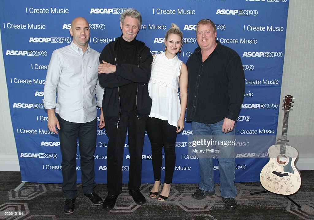 Creative Director Robert Filhart, ASCAP / Songwriter, Author Ralph Murphy, ASCAP Creative Director Beth Brinker and Senior Creative Director Mike Sistad pose with a #StandWithSongwriters guitar, which will be presented in May to members of Congress to urge them to support reform of outdated music licensing laws, during the 2016 ASCAP 'I Create Music' EXPO on April 30, 2016 in Los Angeles, California.