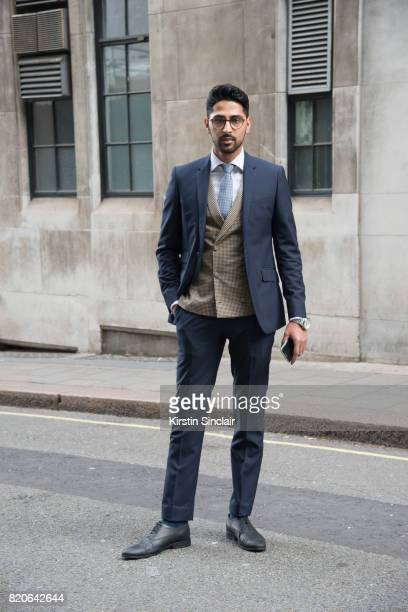 Creative director Saad Wadia wears Zara shoes and glasses and a Saran Kohli suit waistcoat shirt and tie on day 1 of London Collections Men on June 9...
