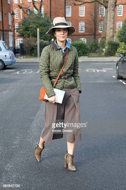 Creative Director Shini Park wears a Gucci bag Hoss Intropia hat Topshop Culottes Barbour jacket Leviâs shirt jacket and Thakoon boots on February 24...