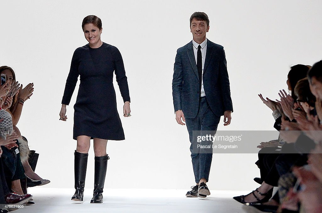 Creative Directors <a gi-track='captionPersonalityLinkClicked' href=/galleries/search?phrase=Maria+Grazia+Chiuri&family=editorial&specificpeople=5551257 ng-click='$event.stopPropagation()'>Maria Grazia Chiuri</a> and <a gi-track='captionPersonalityLinkClicked' href=/galleries/search?phrase=Pier+Paolo+Piccioli&family=editorial&specificpeople=5551258 ng-click='$event.stopPropagation()'>Pier Paolo Piccioli</a> appear at the end of the runway after the Valentino show as part of the Paris Fashion Week Womenswear Fall/Winter 2014-2015 on March 4, 2014 in Paris, France.