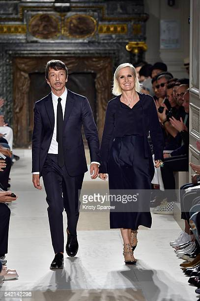 Creative Directors Pier Paolo Piccioli and Maria Grazia Chiuri acknowledge the audience during the runway during the Valentino Menswear Spring/Summer...