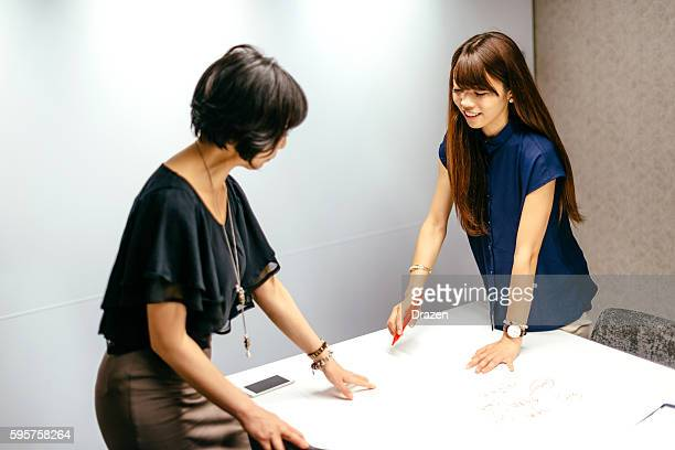Creative Japanese businesswomen working in office