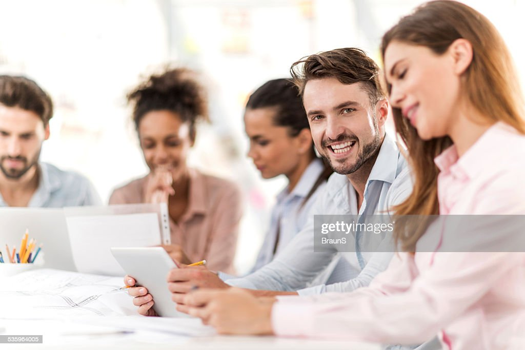 Creative man using touchpad on a meeting. : Stock Photo