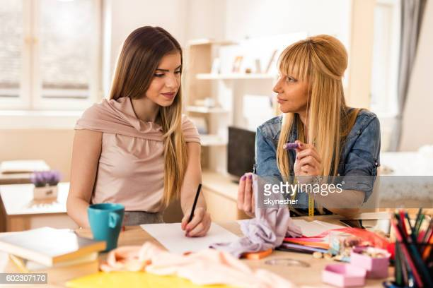 Creative mother and daughter working on new fashion project.