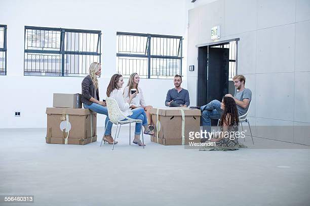 Creative office people meeting before moving in