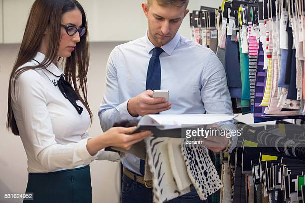 Creative people choosing fabrics