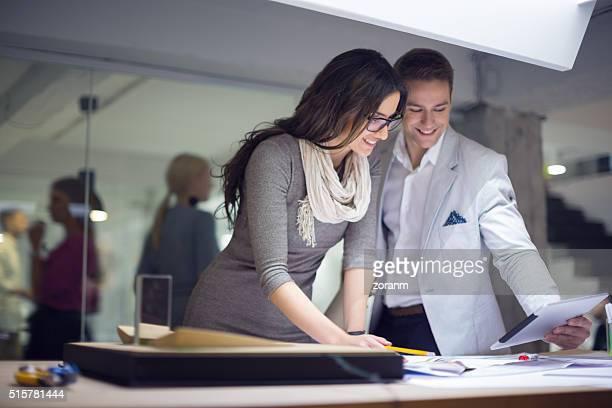 Creative people using digital tablet in studio