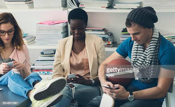 Creative People Using Smart Phones in Office.