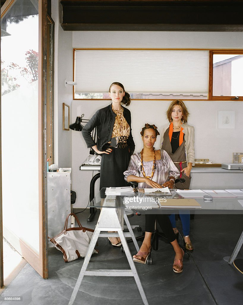 Creative professionals in modern office : Stock Photo