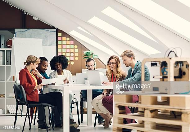 Creative Start-Up Business Team Brainstorming Together.