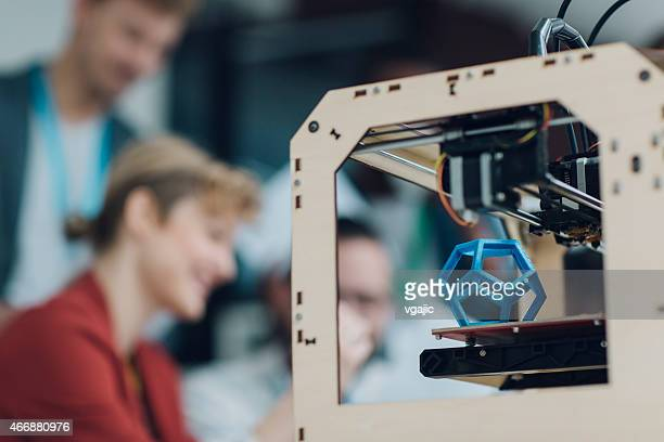 Creative Start-Up Business Team Working by 3D Printer.