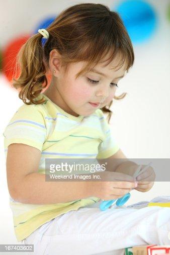 Creative toddler with scissors : Bildbanksbilder