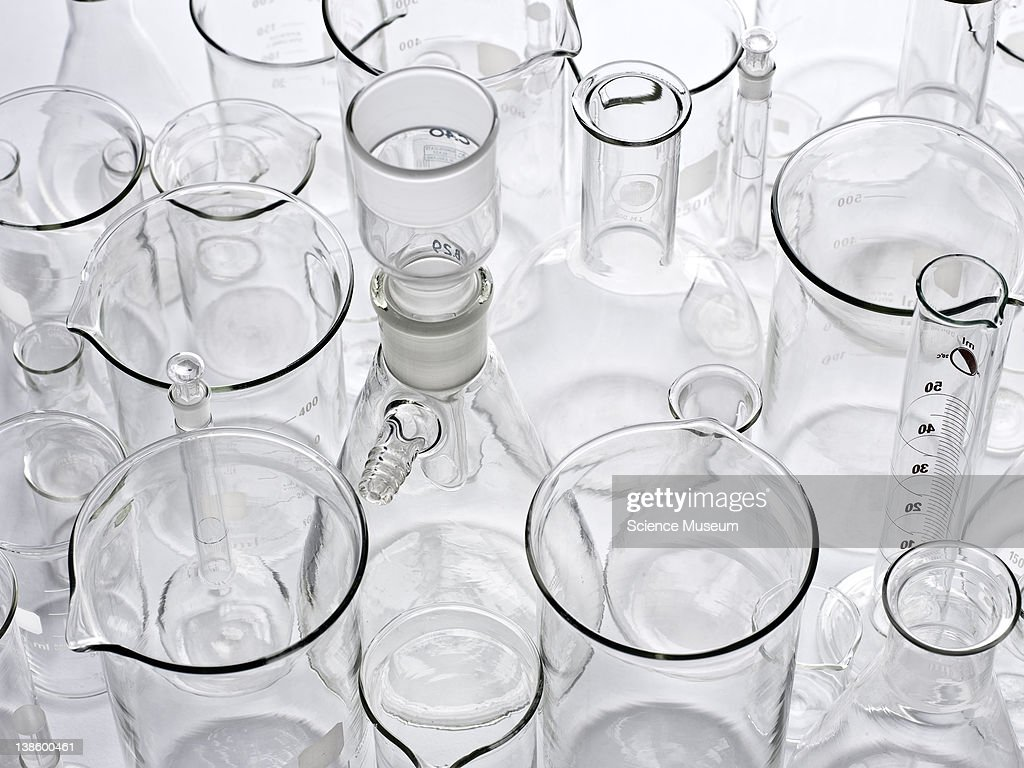 Creative views of lab equipment. Empty bottles, test-tube racks, pyrex test-tubes, two burettes. Images have been retouched for creative purposes, some elements might have been altered.