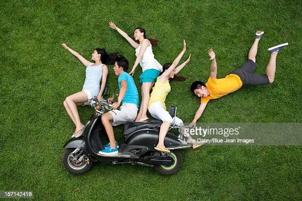 Creative young people imitating riding motorbike