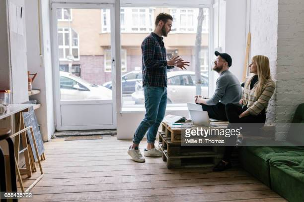 Creatives businessman leading casual business meeting